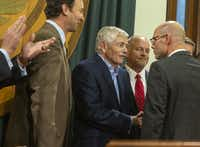 At center, Rep. Tom Craddick, R-Midland, shakes hands with Rep. Dennis Bonnen, R-Angleton, after Bonnen announces he has the votes to be elected the next speaker of the Texas House when the Legislature convenes on Jan. 8. When Craddick was speaker from 2003-2009, Bonnen was an ally and chairman of the House Environmental Regulation Committee.(Stephen Spillman/<i>Austin American-Statesman</i>)