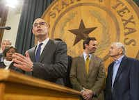 At Bonnen's announcement Monday that he has the votes to become speaker, standing behind him were two GOP state representatives who were said to have been helpful in rallying GOP members behind his candidacy -- Fort Worth's Craig Goldman, right of Bonnen and wearing a gold tie, and Muenster's Drew Springer, far left.(Stephen Spillman/<i>Austin American-Statesman</i>)