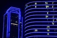 Bank of America and the Omni Dallas Hotel glow blue as the downtown Dallas skyline lights up in blue in recognition of National Police Week on May 15, 2017. (Smiley N. Pool/Staff Photographer)