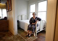 Patricia Puckett Hall poses for a photo inside the small room in her house on North Beckley Avenue in Dallas, where Lee Harvey Oswald was living on Nov. 22, 1963, the day President John F. Kennedy was assassinated.(2013 File Photo/Vernon Bryant)