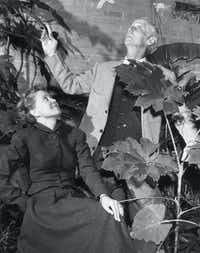This 1952 photograph of Dominique de Menil (left) and surrealist Max Ernst was taken in the courtyard of the de Menil house in Houston.(1952 File Photo/Houston Chronicle)