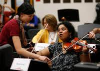 Aparna Viswanathan gets help from Frisco Liberty High School's assistant director of orchestra Victoria Lien during practice at Liberty High School in Frisco on Nov. 7. (Vernon Bryant/Staff Photographer)