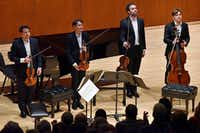 The Modigliani String Quartet stands to an applauding audience during a concert presented by the Dallas Chamber Music Society at Southern Methodist University's Caruth Auditorium in Dallas on Nov. 19, 2018.(Ben Torres/Special Contributor)