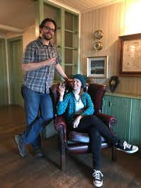 J. David McSwane and Lauren McGaughy have a drink in the reception room at the Lagavulin Distillery on the island of Islay in Scotland.(Lauren McGaughy/Staff)