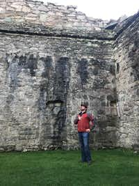 J. David McSwane reflects on his ancestry at Castle Sween in Argyll, Scotland.(Lauren McGaughy/Staff)