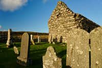 Kilmory Knap Chapel, a short drive up the promontory from Castle Sween, was built by Christians in the 13th century. Many of its ornate headstones, mostly from the 14th and 15th centuries, indicate a blending of a Norse-Gaelic maritime people. (J. David McSwane/Staff)