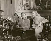 """Bing Crosby and Marjorie Reynolds perform&nbsp; """"White Christmas"""" in&nbsp;<i>Holiday Inn</i>.  From<i> Bing Crosby: Swinging on a Star</i>, by Gary Giddins.&nbsp;(HLC Properties Ltd./Little, Brown)"""