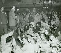 Bing Crosby, backed by John Scott Trotter, at the Hollywood Canteen in 1944. From <i>Bing Crosby: Swinging on a Star</i>, by Gary Giddins.(HLC Properties, Ltd./Little, Brown)