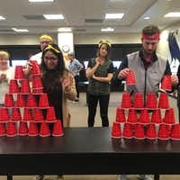 In celebration of the 2018 Winter Olympics, Republic Title of Texas held an extremely competitive) Office Olympics at its Corporate and Commercial headquarters Teams of five competed in games like cup-stacking.(Republic Title of Texas)