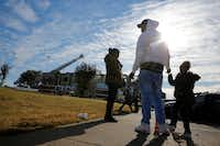 Linda Smith (from left), Courtney Turner and Jasmine Dixon wait to leave their complex during an apartment fire near the intersection of Interstate 635 and Ferguson Road in Dallas.(Nathan Hunsinger/Staff Photographer)