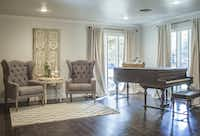 A living room redone by Chip and Joanna Gaines of HGTV s Fixer Upper As seen on Fixer Upper, the sitting room has a very elegant look with its antique piano and high backed chairs. [ 2015PUB - 2015MARCH ] 03282015xARTSLIFE(Jennifer Boomer/Getty Images)