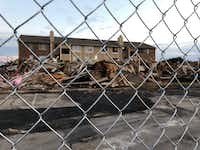 The burned Meadows at Ferguson Building F was demolished Wednesday afternoon.(Sharon Grigsby/Dallas Morning News)
