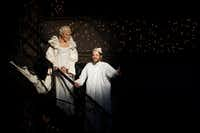 "Cara Statham Serber is the Ghost of Christmas Past and Alex Organ is Ebenezer Scrooge in Dallas Theater Center's ""A Christmas Carol"" at the Wyly Theatre through Dec. 30.(Lawrence Jenkins/Special Contributor)"