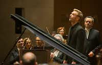 Pianist Andrew Von Oeyen, left, followed by conductor Andrew Grams enter the stage before they perform Grieg's Piano Concerto in A minor, Op. 16 with the Dallas Symphony Orchestra at the Meyerson Symphony Center in Dallas on Friday, November 23, 2018. (Daniel Carde/Staff Photographer)