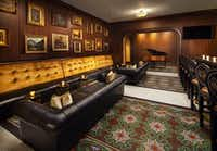 """A """"live it up"""" vibe energizes the wood-paneled St. Anthony Club. Opened by cattlemen in 1909 as downtown San Antonio's first luxury hotel, the St. Anthony became a go-to spot for hip locals after its multimillion-dollar restoration in 2015.(The St. Anthony)"""
