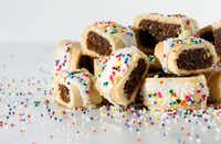 Cucidati, a fig cookie with sprinkles photographed (Vernon Bryant/Staff Photographer)