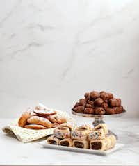 Casadetti, a ricotta cookie in a pie dough, Turdilli, an Italian Wine Cake, and Cucidati, a fig cookie with sprinkles (Vernon Bryant/Staff Photographer)