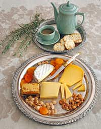 Cheese trays with hot tea(Louis DeLuca/Staff Photographer)