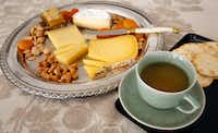 An oolong tea paired with cheddar, comte and soft-ripened cheese from Vermont(Louis DeLuca/Staff Photographer)