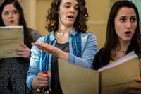 From left: Singers Elizabeth McGee, Erinn Sensenig and Lauren Stroh of the Verdigris Ensemble rehearse composer David Lang's <i>The Little Match   Girl Passion.</i>(Carly Geraci/Staff Photographer)