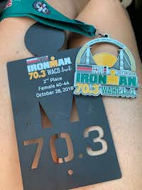 The finishers  medal and Brandi Grissom Swicegood's 2nd place trophy from Ironman 70.3 Waco.(Brandi Swicegood)