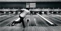 Charlie McPhee took a shot on the Bronco Bowl's lanes in 1990.(1990 File Photo/Staff)