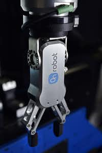 An OnRobot electric gripper is used by All Axis Machining in Dallas. The machine shop has seven robots that are used for tasks, including sanding metal and checking for quality control.(Ben Torres/Special Contributor)