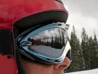 The lofty peaks of the San Juan Mountains reflect from a skier's goggles at the Purgatory Resort north of Durango, Colo.  Mountain scenery is one more reason to head for the hills in the winter.(Dan Leeth/Special Contributor)