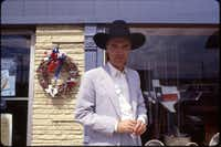 David Byrne poses in front of a Mansfield store during filming.(Christina Patoski)
