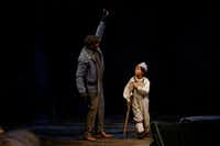 "Jahi Kearse as Bob Cratchit and Olivia Meredith (alternating with Cooper Carter) as Tiny Tim in Dallas Theater Center's ""A Christmas Carol""  at the Wyly Theatre.(Lawrence Jenkins/Special Contributor)"