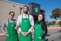 From left: Employees Erykah London, Edmund Young and Vania Perez outside Starbucks in Dallas.(Carly Geraci/Staff Photographer)