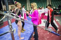 Nastia Liukin, center, talks with gymnast Alyssa Baumann, left, before Baumann competes during the  WOGA Classic at the Dr. Pepper Arena on Saturday, Feb. 14, 2015, in Frisco. (Smiley N. Pool/Staff Photographer)