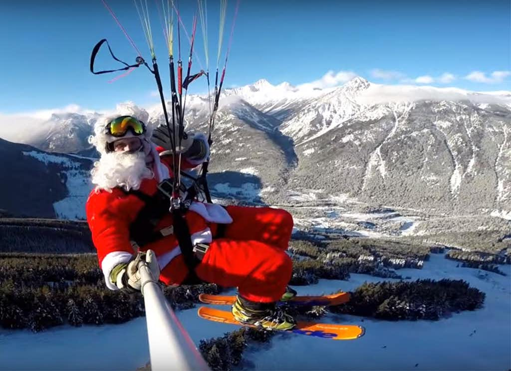 Santa takes flight on Rollercoaster Run, paragliding down into British Columbia's Panorama Mountain Resort on Christmas morning.(Courtesy/Panorama Mountain Resort)
