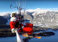 Santa takes flight on Rollercoaster Run, paragliding down into British Columbia's Panorama Mountain Resort on Christmas morning.(Courtesy/Panorama Mountain Resort)