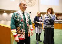 At the final council meeting of 2016, the council members wore Christmas sweaters. Mark Clayton, left, wore his mother's. Gates wore one reminding everyone of her father.(Tom Fox/Staff Photographer)