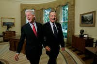 Former Presidents Bill Clinton and George H.W. Bush in the Oval Office after a joint statement with President George W. Bush regarding Hurricane Katrina relief in Washington on Sept. 1, 2005.(Doug Mills/The New York Times)