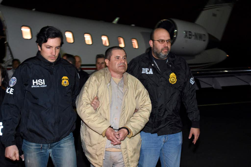 "In this Jan. 19, 2017, photo provided by U.S. law enforcement, authorities escort Joaquin ""El Chapo"" Guzman, center, from a plane to a waiting caravan of SUVs at Long Island MacArthur Airport, in Ronkonkoma, N.Y. The Mexican drug lord is currently on trial in New York City.(AP)"
