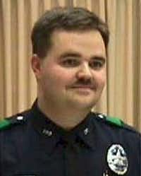 Officer Aubrey Hawkins was killed as he investigated a robbery at an Oshman's Sporting Goods store in Irving.(Courtesy)