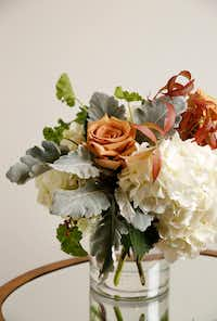 Floral arrangement including hydrangeas, Combo rose, geranium leaves, dusty miller and pistachio leaves from Avant Garden.(Rose Baca/Staff Photographer)