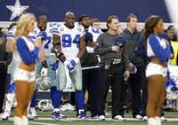 <div>Josh Brent (center, in jersey and dark pants  and holding cap) was on the sidelines at a Cowboys game on Dec. 16, 2012, one day after Brent's teammate and best friend, Jerry Brown, was buried.</div><div></div>(File Photo/Staff )