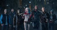 (From left)  Jay Hernandez as Diablo, Jai Courtney as Boomerang, Adewale Akinnuoye-Agbaje as Killer Croc, Margot Robbie as Harley Quinn, Will Smith as Deadshot, Joel Kinnaman as Rick Flag and Karen Fukuhara as Katana in <i>Suicide Squad</i>.(Clay Enos/TM & (c) DC Comics)