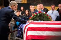 Jonathan J. Bush the brother of the former President, visits the flag-draped casket of President George H.W. Bush as he lies in the Rotunda of the U.S. Capitol on Tuesday, Dec. 4, 2018, in Washington.(Smiley N. Pool/Staff Photographer)