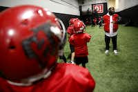 Tevar Watson coaches during a Hamilton Park Bobcats youth football league practice.(Rose Baca/Staff Photographer)