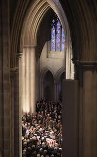 A military honor guard carried the flag-draped casket into the Washington National Cathedral at the beginning of the state funeral.(Smiley N. Pool/Staff Photographer)
