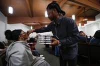 Samantha Barber receives communion from her husband Terrence Barber during a worship service at Airport Freeway Church of Christ in Euless.(Ryan Michalesko/Staff Photographer)
