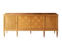 The Veronique Credenza's details include checkerboard veneer doorfronts and brass hardware and sabots. The piece is $12,900.(Stephen Karlisch)
