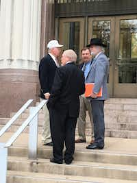 Three officers of the state arm of the Sons of Confederate Veterans and a supporter stand outside the Transportation Department Building in Austin on Thursday, Dec. 6, 2018. From left to right: chief of staff Bill Boyd of College Station; commander David McMahon of San Angelo; and lieutenant commander John McCammon of San Angelo. The man wearing a black hat declined to identify himself but said he attended to support the group's push for a specialty Texas license plate.(Robert T. Garrett/The Dallas Morning News)