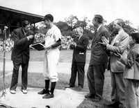 Baseball legend Babe Ruth presented the manuscript of his autobiography to Yale University in 1948. They were received by the Yale baseball team captain — George Bush (in uniform). Also present were: Bob Kiplurth, Yale athletic director; Professor James T. Babb, Yale librarian for preservation; and Mayor William Celentano and his son.(George Bush Presidential Library/MCT)