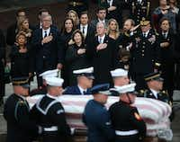 The Bush family, including former President George W. Bush, Laura Bush, Jeb Bush and Columba Bush watch as the flag-draped casket of former President George H.W. Bush is carried by a joint services military honor guard from the funeral train pulled by a custom-painted Union Pacific Locomotive 4141 to his final resting place at the George H. W. Bush Presidential Library Center on Texas A&M University campus in College Station, Texas on Thursday, Dec. 6, 2018. (Rose Baca/The Dallas Morning News)