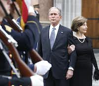 Former President George W. Bush and wife Laura Bush watch as the honor guard walks away at the funeral service for George H.W. Bush, the 41st President of the United States, at St. Martin's Episcopal Church in Houston on Thursday, December 6, 2018. (Louis DeLuca/The Dallas Morning News)